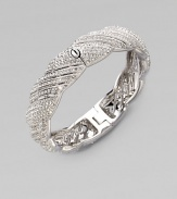 A beautiful twisted motif encrusted in pavé crystals for an exquisite design. Rhodium plated brassCrystalsDiameter, about 2¼Hinged push clasp closureImported