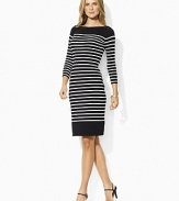 Infused with nautical inspiration, this timeless boat neck dress is finished with horizontal stripes, three quarter length sleeves and chic laced detail at the shoulders.