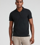 Slim fit polo with three button placket and logo tab at the hem.
