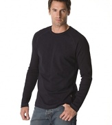 Long sleeved raglan tee with ribbed sleeves and side panels. Crew neck.