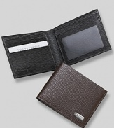 Salvatore Ferragamo Revival bifold wallet. Textured leather bifold wallet with silver engraved Ferragamo plate on front. Features double billfold with three card slots on one side and one window slot with two card slots on the other .