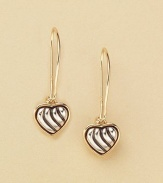 Pretty heart drop earrings dangle from sterling silver with 18kt gold accents. Imported