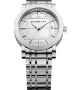 This Burberry watch features a stainless steel bracelet and case. Silvertone etched check dial with logo, date window at 3 o'clock and polished silvertone indices. Three hands. Swiss movement. Water resistant to 30 meters. Two-year limited warranty.