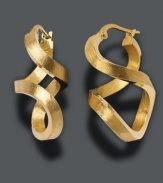 Add a new dimension to your look with figure 8 hoop earrings in 14k gold. Approximate drop: 1 inch.