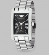 A solid stainless bracelet band offsets a black dial on this signature timepiece. Quartz movement Rectangular case Roman numeral markers Sub dial with second hand Imported