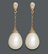 Sophisticated style perfect for the office or an evening out. Elegant drops feature cultured freshwater pearls (8 x 11 mm) strung from delicate chains crafted in 14k gold with sparkling diamond-accented posts. Approximate drop: 1-1/10 inches.