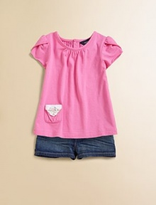 Adorable petal sleeve top in soft cotton jersey with decorative patch pocket.Gathered crewneckShort petal sleevesBack buttonsFront patch pocketCottonMachine washImported Please note: Number of buttons may vary depending on size ordered.