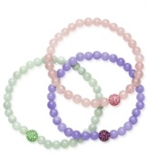 Solo standouts, but lovely layered too. This trio of stretch bracelets adds a playful touch to any look. Each bracelet is composed of jade rose quartz and crystal beads (6 mm) in mint green, lavender and light pink hues. Approximate length: 7 inches.