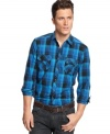This INC International Concepts button down offers a sleek fit and a rugged plaid design.