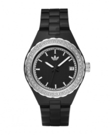 A sport watch with fashion sensibilities, the Cambridge by adidas. Black polyurethane strap and round black plastic case. Silvertone bezel crystallized with Swarovski elements. Black grid-patterned dial features applied luminous silvertone stick indices, date window at three o'clock, luminous hands and white logo. Quartz movement. Water resistant to 50 meters. Two-year limited warranty.