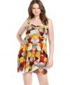 Look pretty in print with American Rag's sleeveless plus size dress, defined by a banded waist-- it's über-cute for the season!