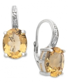Introducing sunshine-inspired hues! Victoria Townsend's beautiful drop earrings feature oval-cut citrine (4-3/4 ct. t.w.) and sparkling diamond accents. Crafted in sterling silver with a leverback setting. Approximate drop: 3/4 inch.